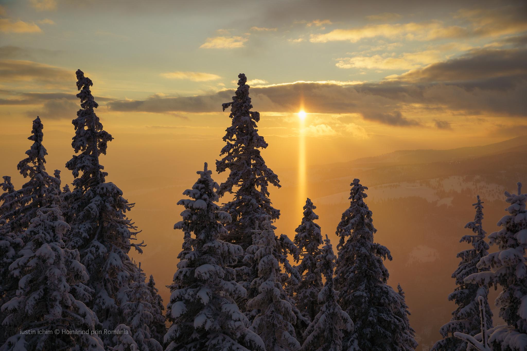 Peisaj de iarnă, apus de soare